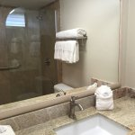 Remodeled bathroom with granite counters, Kohler fixtures and shower at our Royal Kahana condo