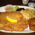 Delicious pork schnitzel, spatzel, potato pancakes