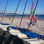 Boats and windsurfer on St Aubins beach