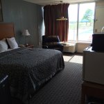 "Hallway smells like smoke even though the rooms say ""No Smoking "" .  Rooms are clean although th"
