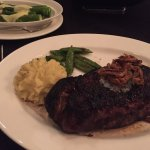 NY strip steak with garlic mashed potatoes and snap peas.
