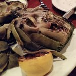 Tasty grilled artichokes with delicious dipping sauces.