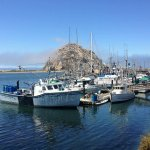 View from the Embarcadero of fishing boats and Morro Rock, in Morro Bay, California.