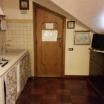 The entry door, kitchenette - seating area behind me.