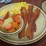 Scrambled, bacon and a bowl of fruit