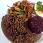 Jaegerschnitzel with cabbage and veggies