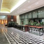 Lobby with long table where complementary breakfast is served
