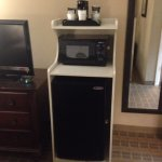 Microwave and mini-fridge.