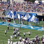 the traditional running of the flags after a touchdown