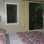 Small room looking onto rainforest gardens