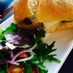 """A lo pore"" sandwich with salad"