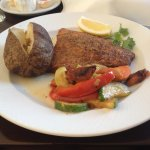 Trout with baked potato and vegetables
