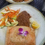 Salmon (lower)...Crab cakes...both with mashed sweet potatoes and vegetables sides.