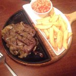 8oz Rump Steak, chips and baked beans served on a skillet of mushrooms and onions!