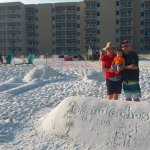 View of the condo with sand art on the beach for photo ops