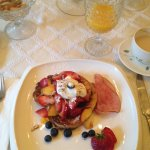 French Tast with Fresh Fruit, Yogurt, and Nuts served with Orange Juice and Chai Tea