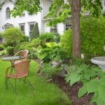 Cozy Seating Near Nicely Manicured Gardens at Blue Forest Lane Bed and Breakfast