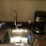 Sink and coffee machine in kitchen