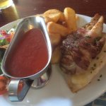 Chicken wrapped in bacon with a tomatoe and red pepper sauce.