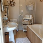 Bathroom with bath, toilet and washbasin. Towels, Care products are available.