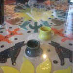 Painted items under our glass-topped table.