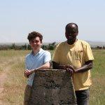 My son and John at the Tanzania / Kenya Border