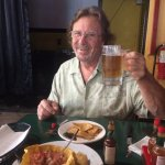 Enjoying the Gallo Pinto and Artesan Beer. Note the big smile.