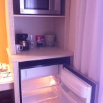 Microwave, coffee maker (coffee packs provided daily) and fridge