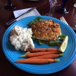 The almond crusted haddock on baby spinach with mashed potatoes and carrots