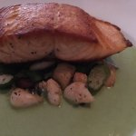 Perfectly cooked salmon served with pancetta, light-as-air gnocchi, and asparagus coulis.