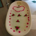 Flowers with a bath drawn by our Room Boy after we got engaged at the resort