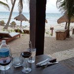 There are tables in the back overlooking the small beach.