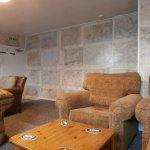 The back room with comfy seating & maps for wallpaper