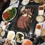 Bolgogi and Octopus on the grill, Spicy Pork Belly on the plate