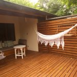 This is the outside patio of the Cocos rooms, with sofa and hammock