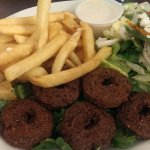 Falafel Plate with fries and salad sides.