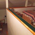 the loft is open to below and room sleeps 5