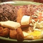 gallo pinto, yuca frita, fried plantain, ribeye steak, eggs, queso fresco and cabagge salad..