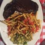 Steak bordelaise. Cooked perfectly. Fries were crispy. The seasoning along with the sweetness of