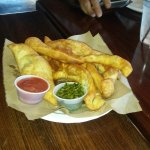 This is Sgabei - fried bread dough with dipping sauces