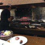 Love this restaurant. Rustic design, friendly staff, veteran grill master Chef Hugo could make c