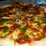 Vego and meaty 15 inch thin crust pizza for lunch & dinner.