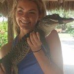 Holding the baby gator.