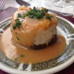 Haggis, neeps and tatties tower with whisky sauce (traditional Scottish meal)