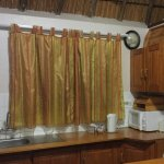Fully equipped kitchen: fridge & freezer, microwave, mini stove top & oven, crockery, cutlery et