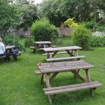 Garden dining room - idyllic setting in the midst of the village; very dog- and kid-friendly