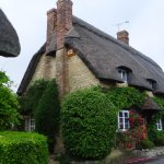 Thatched cottage on High Street enroute to Eight Bells from the Village Square.