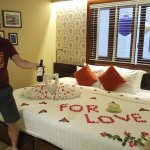 Fantastic bed display, and wine and cake for our honeymoon trip!
