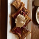 french toast with berries hazelnuts and cream