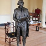 Bronze statue of Washington resigning